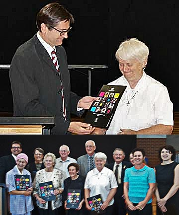 Federal Minister, Greg Combet presented Sister Diana Santleben with the Australia Ambassadors award.